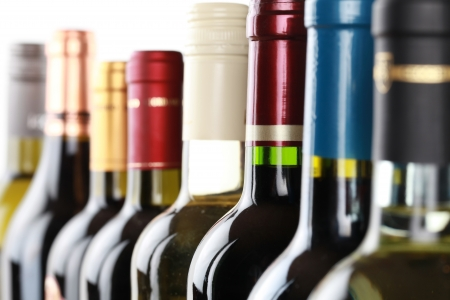 wine tasting: Wine bottles in a row isolated on a white background Stock Photo