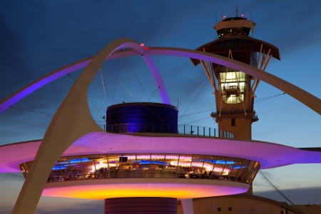 Theme Building and tower of Los Angeles International Airport at dusk