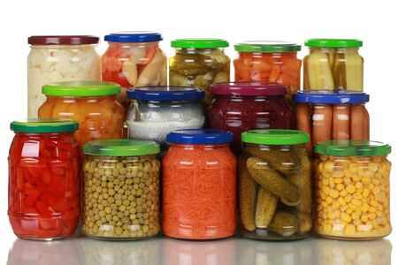 canned peas: Canned vegetables in glass jars, isolated on white Stock Photo