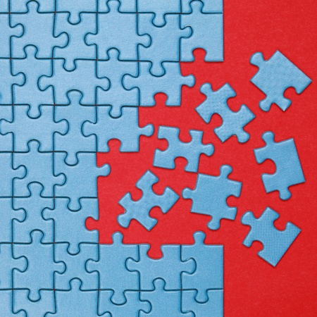 Pieces of a jigsaw puzzle have to be put in the right place photo