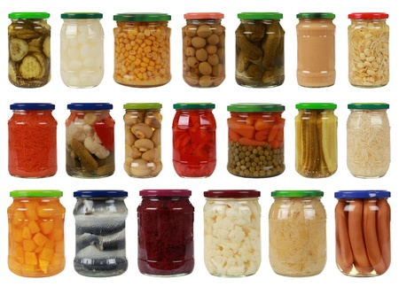 canned peas: Collection of canned vegetables in glass jars, isolated on white Stock Photo