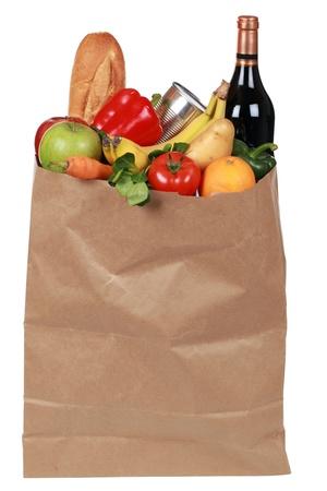 bolsa de pan: Tiendas de comestibles en una bolsa de papel, incluyendo frutas, verduras, conservas y una botella de vino