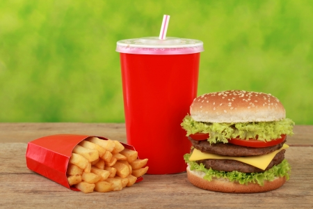Cheeseburger combo meal with french fries and a cola drink photo