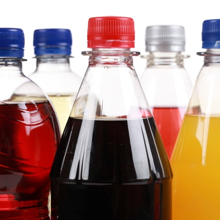 Soda in plastic bottles isolated on a white background photo