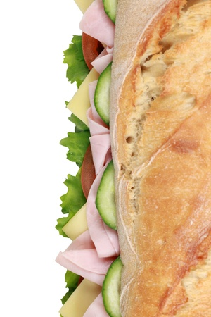 Fresh baguette with ham, cheese, tomatoes, lettuce and cucumber from above photo