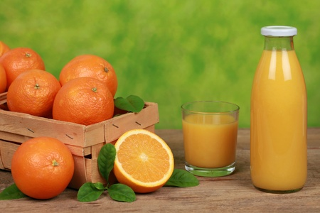Oranges and fresh orange juice in a bottle Stock Photo - 19862218
