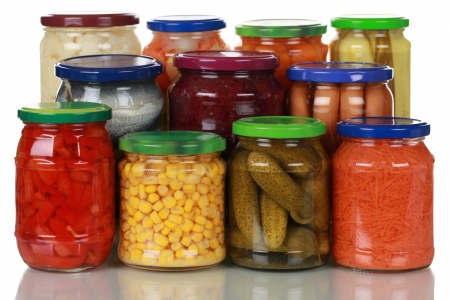 canned peas: Canned vegetables such as corn, pickles and paprika in glass jars