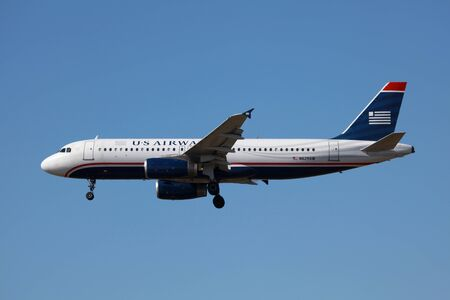 lax: Los Angeles, California - March 21, 2013: A US Airways Airbus A320 with the registration N629AW on approach to Los Angeles Airport (LAX) in California. US Airways is a major U.S. airline, headquartered in Tempe, Arizona. It operates with 644 aircraft and  Editorial