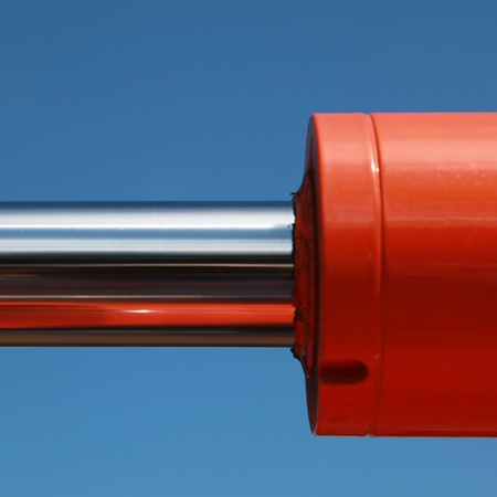 Hydraulic parts of a construction machine over blue sky photo