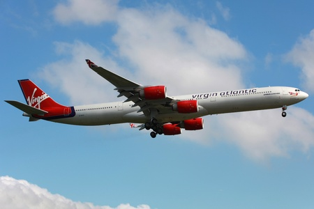 London Heathrow, United Kingdom - May 25, 2013: A Virgin Atlantic Airbus A340-600 with the registration G-VFIT on approach to London Heathrow Airport (LHR) in the United Kingdom. Virgin Atlantic Airways is a British airline with 43 planes and 5.5 million