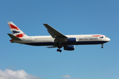 aircraft landing: London Heathrow, United Kingdom - May 25, 2013: ABritish Airways Boeing 767-300ER with the registration G-BNWI on approach to London Heathrow Airport (LHR) in the United Kingdom. British Airways is the flag carrier airline of the United Kingdom with its m