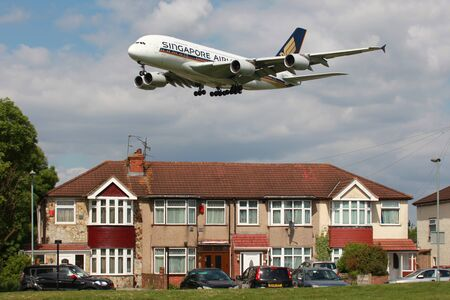 London Heathrow, United Kingdom - May 25, 2013: A Singapore Airlines Airbus A380 Superjumbo with the registration 9V-SKA on approach to London Heathrow Airport (LHR) in the United Kingdom. The Airbus A380 is the worlds largest passenger airliner. Singapo