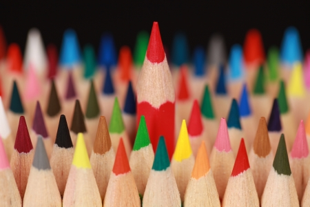 Concept picture red pencil standing out from the crowd