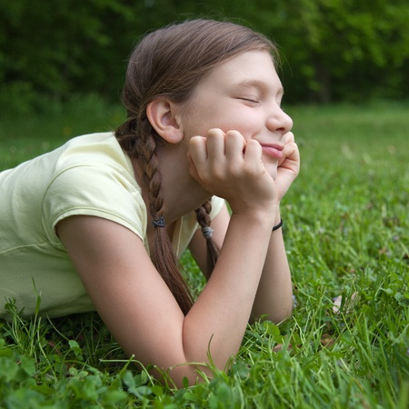 Portrait of a little girl enjoying her free time in nature photo