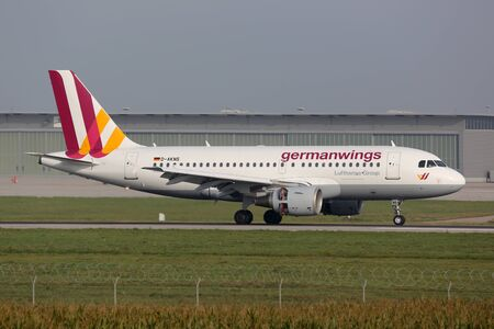 str: Stuttgart, Germany - October 2, 2013: A Germanwings Airbus A319 with the registration D-AKNS landing at Stuttgart Airport (STR) in Germany. Germanwings is a low-cost airline which is wholly owned by Lufthansa.