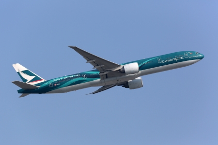 livery: Hong Kong, China - September 26, 2013: A Cathay Pacific Boeing 777-300ER in special livery with the registration B-KPF takes off from Hong Kong International Airport (HKG) in China. Cathay Pacific is the flag carrier airline of Hong Kong with its main hub