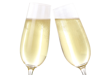 clinking: Making a toast with two glasses filled with sparkling Champagne