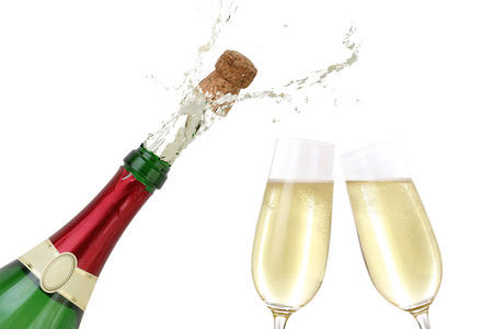 popping out: Champagne splashing out of the bottle with a popping cork