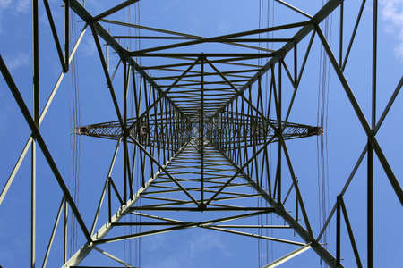 electricity pylon: Electricity pylon from below, power supply and energy topic Stock Photo