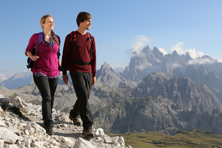 trekker: Young couple hiking in the mountains Alps Italy Stock Photo