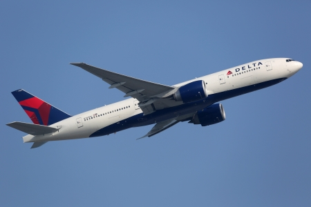Hong Kong, China - September 26, 2013: A Delta Air Lines Boeing 777-200LR with the registration N709DN takes off from Hong Kong International Airport (HKG) in China. Delta Air Lines is the worlds largest airline with 733 planes and some 160 million passe