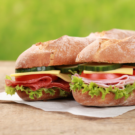 ciabatta: Two baguettes with pepperoni, ham, cheese, tomatoes and cucumber