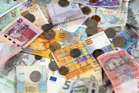 swiss franc: Many banknotes and coins like Euro, Dollar, Swiss Franc, Pound and Rubel Stock Photo