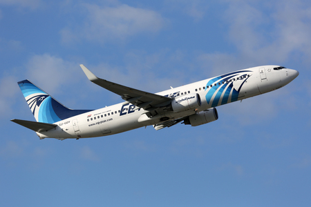 aircraft take off: Munich, Germany - October 26, 2013: An Egyptair Boeing 737-800 with the registration SU-GDY takes off from Munich Airport (MUC) in Germany. Egyptair is the flag carrier airline of Egypt. It operates with 79 aircraft and carries 7 million passengers.