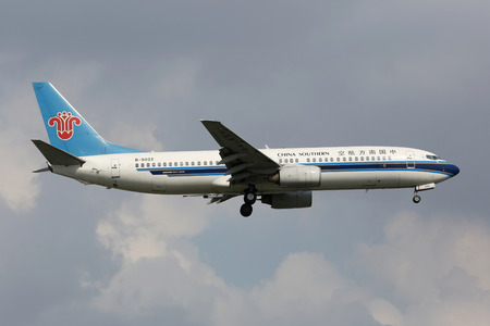 81: Shanghai, China - September 19, 2013: A China Southern Boeing 737-800 with the registration B-5022 approaches Shanghai Airport (SHA) in China. China Southern is Chinas largest airline. It operates with 444 aircraft and carried 81 million passengers in 20 Editorial