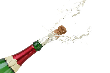 popping out: Champagne splashing out of the bottle with a popping cork on New Years Eve or party  Stock Photo
