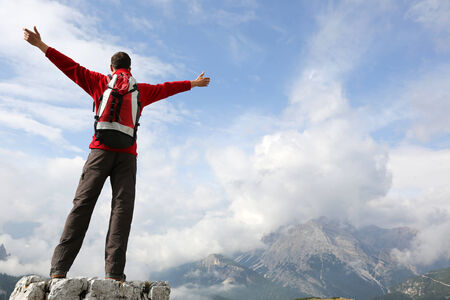 mountaineer: Mountaineer on top of a mountain enjoying his success