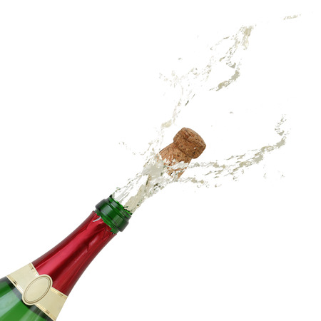 popping cork: Champagne splashing out of the bottle on New Years Eve, party or birthday
