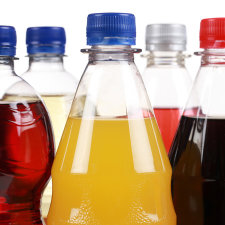 soft drinks: Bottles with soda drinks like cola and orange lemonade, isolated on a white background