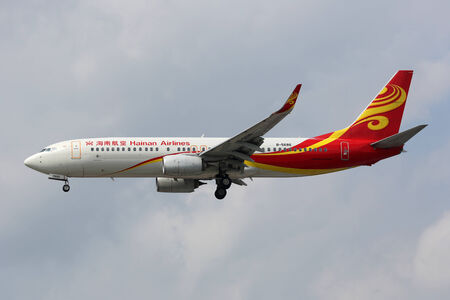 Shanghai, China - September 20, 2013: A Hainan Airlines Boeing 737-800 with the registration B-5686 approaches Shanghai Airport (SHA) in China. Hainan Airlines is a Chinese airline which operates with 132 aircraft and carries 17 million passengers.