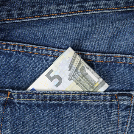 trouser: A 5 Euro money banknote in a trouser pocket, pickpocket topic