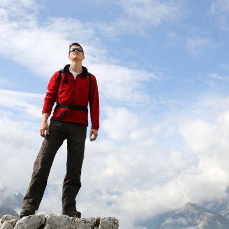 mountaineer: A young mountaineer enjoying his success on a mountain top Stock Photo