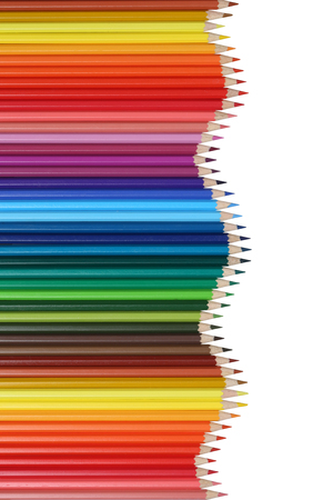 colored pencils: School supplies colored pencils forming a wave, education, success and winning topic