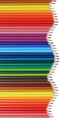 Schoolbenodigdheden kleurpotloden vormen een golf, onderwijs, succes en het winnen onderwerp Stockfoto