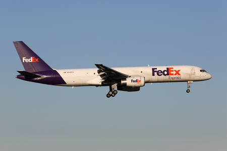 Stockholm, Sweden - June 24, 2013: A FedEx Boeing 757-200 with the registration N916FD on approach to Stockholm Airport (ARN) in Sweden. FedEx is the worlds largest cargo airline. It operates with 642 aircraft.