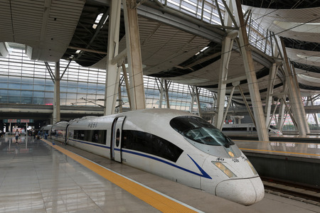 Beijing, China - September 18, 2013: The high-speed train CRH3 in the Beijing South Railway Station in China. The CRH3 is a version of the Siemens Velaro high-speed train similar to the German type ICE3.