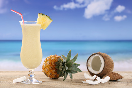 Pina Colada cocktail with fruits on the beach while on vacation photo