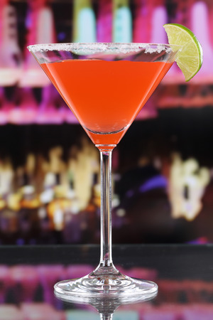 longdrink: Red Martini Cocktail in a glass in a bar or a party