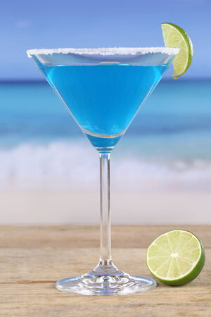 longdrink: Blue Curacao cocktail on the beach while on vacation