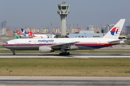 boeing: Istanbul, Turkey - May 28, 2014: A Malaysia Airlines Boeing 777-200 with the registration 9M-MRP takes off from Istanbul Atatürk International Airport (IST) in Turkey. This aircraft is the sister airplane of the plane missing in the Indian Ocean with the
