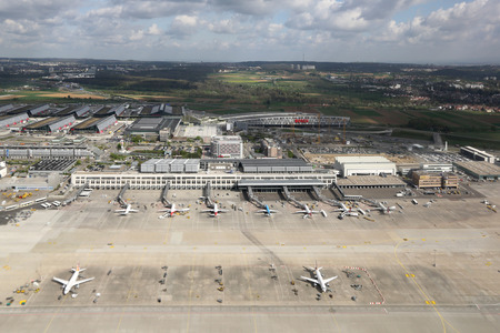str: Stuttgart, Germany - April 9, 2014: Overview of Stuttgart Airport (STR) and the Stuttgart Fair in Germany. Stuttgart is the sixth busiest airport in Germany with 9.6 million passengers in 2013.