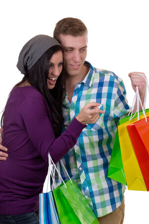 A young couple is finding something while shopping photo