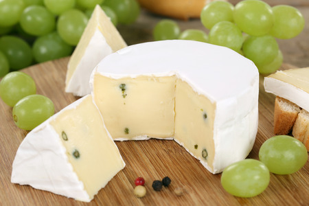 cheese platter: Cheese plate with soft cheese like Camembert or Brie on a wooden board