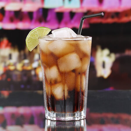 soft drinks: Cold cola drink or Cuba Libre Cocktail with ice cubes in a bar or a party Stock Photo