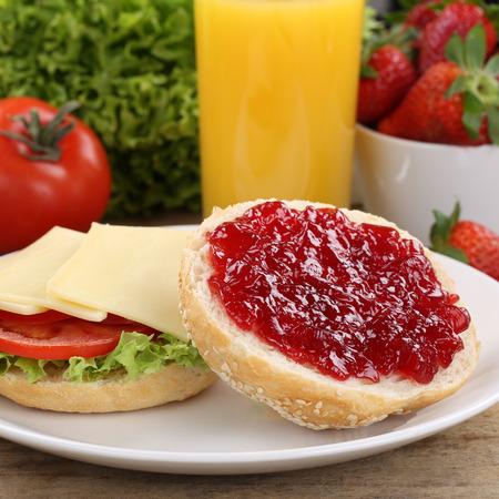 jam sandwich: Breakfast with sandwiches, strawberries and orange juice Stock Photo