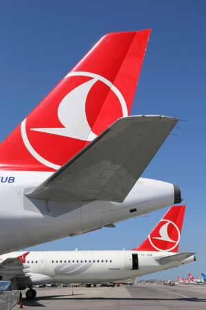 Istanbul, Turkey - May 15, 2014: Tails of Turkish Airlines airplanes at Istanbul Atatürk International Airport (IST) in Turkey. Turkish Airlines is the largest airline of Turkey with its headquarters in Istanbul.